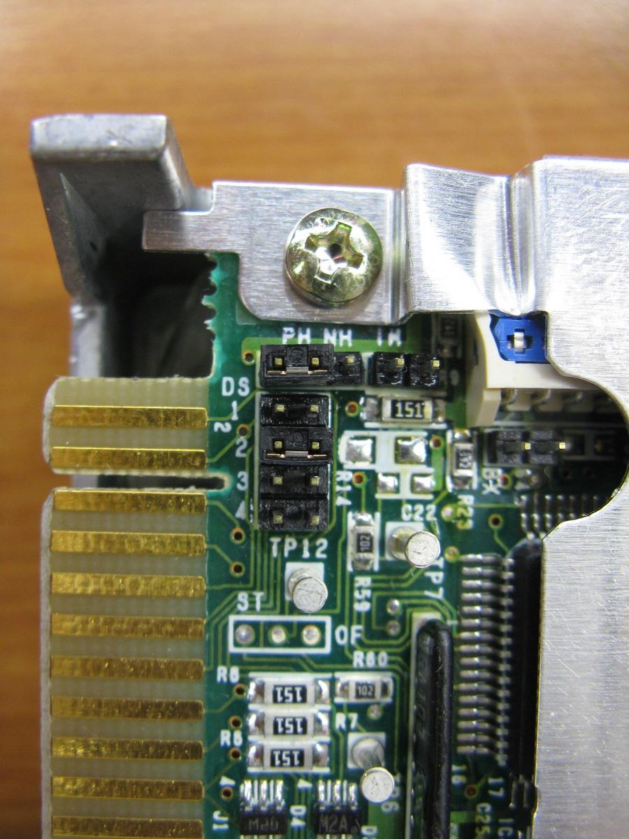 A jumper set on a floppy drive.